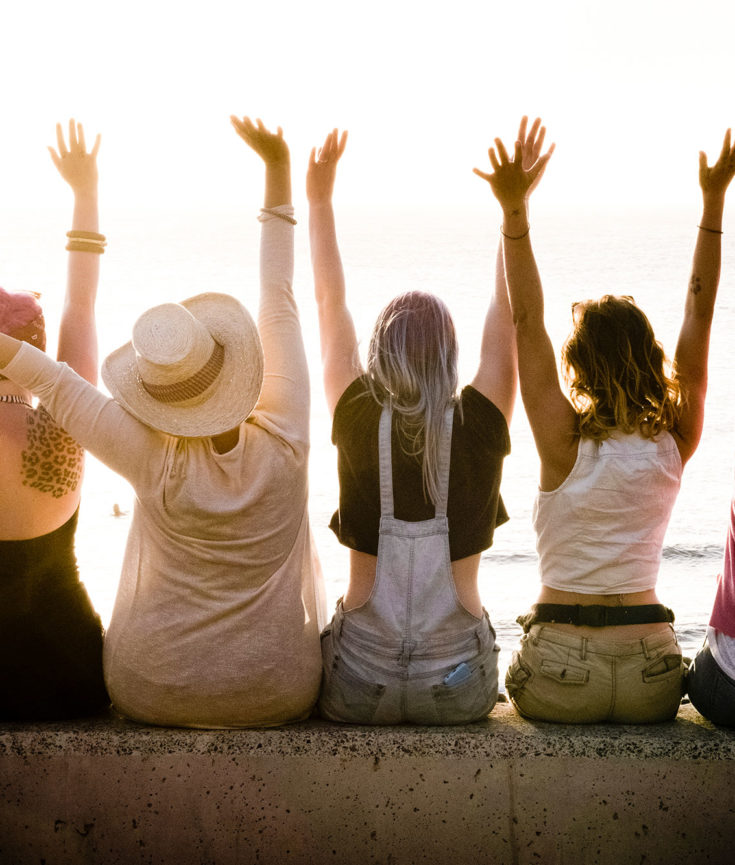 Photo of women with hands up