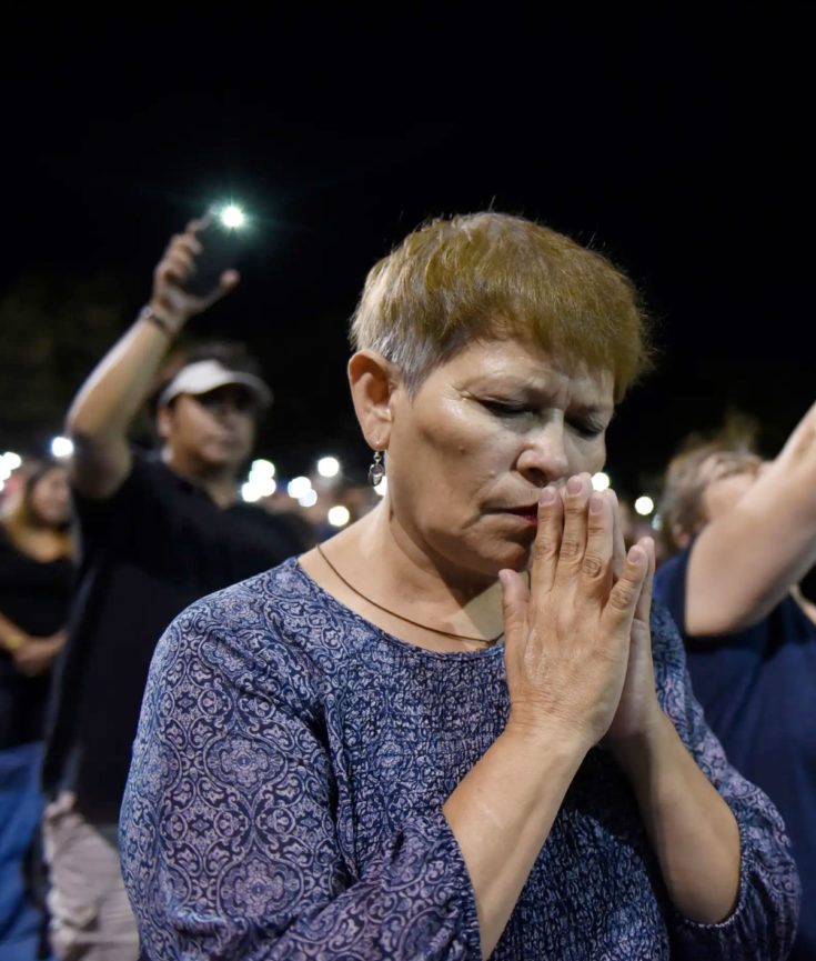 Woman Praying After Mass Shooting